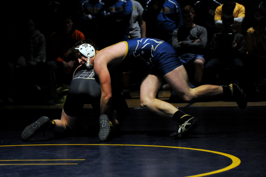 One-hundred-and-seventy-pounder Mikel Dobson hooks the leg of Billings West's Luke Hovis on Tuesday, Jan. 3 at Sheridan High School. Mike Pruden   The Sheridan Press