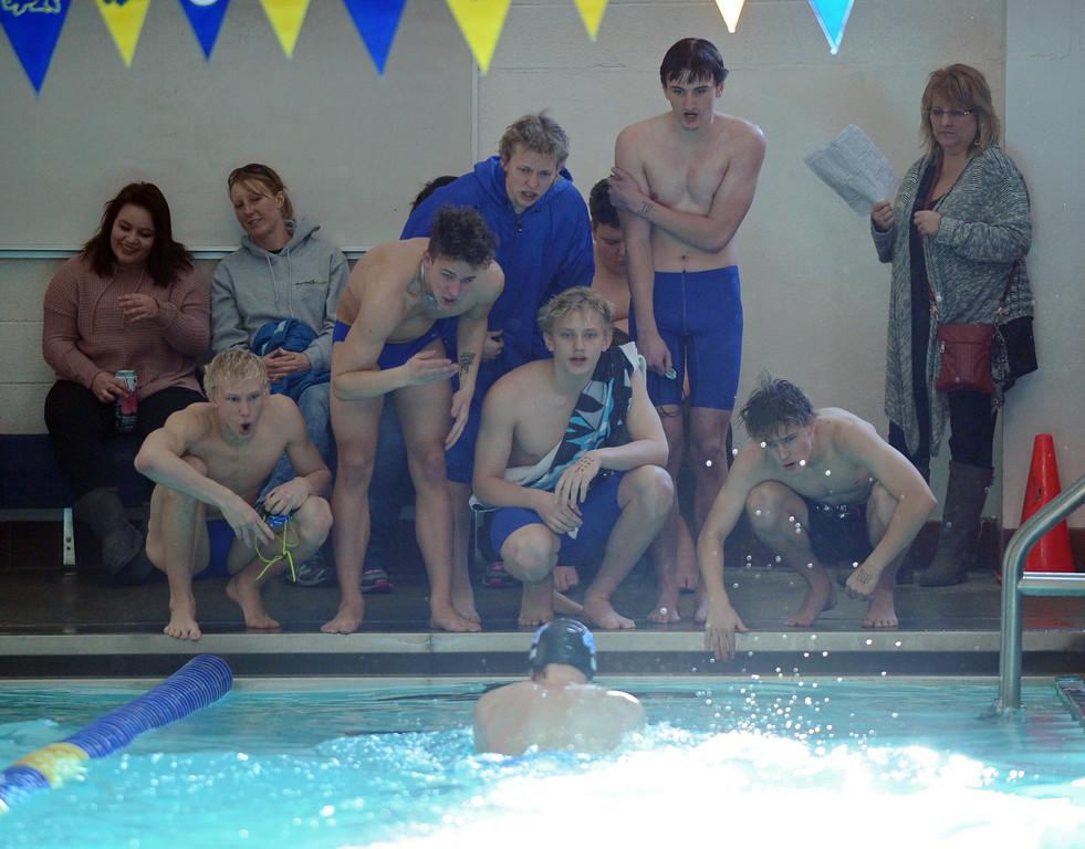 Sheridan swimmers cheer on teammate Noah Luhman during the 100-meter breaststroke at the Sheridan Invite on Saturday, Jan. 7 at Sheridan Junior High School. Mike Pruden   The Sheridan Press