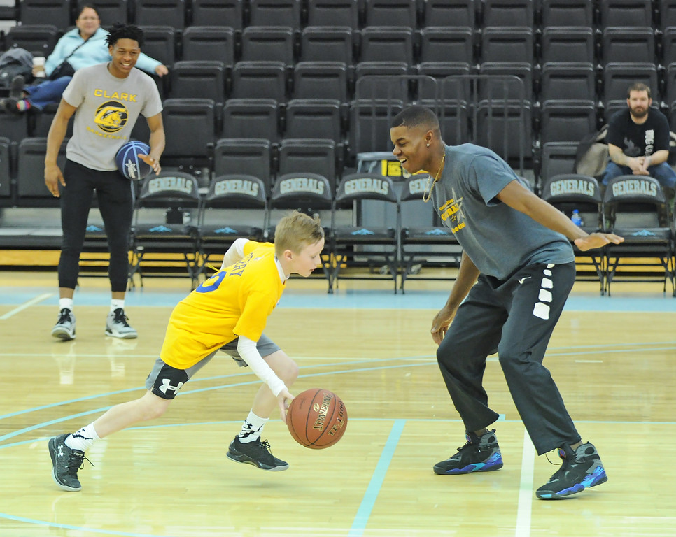 Drew Heermann, left, drives the ball at Sheridan College guard Xavier Jackson during a game of one-on-one at Sheridan College men's basketball camp on Saturday, Jan. 7 at the Bruce Hoffman Golden Dome. Heermann hit a baseline jumper to beat Jackson in a game to 1. Mike Pruden   The Sheridan Press
