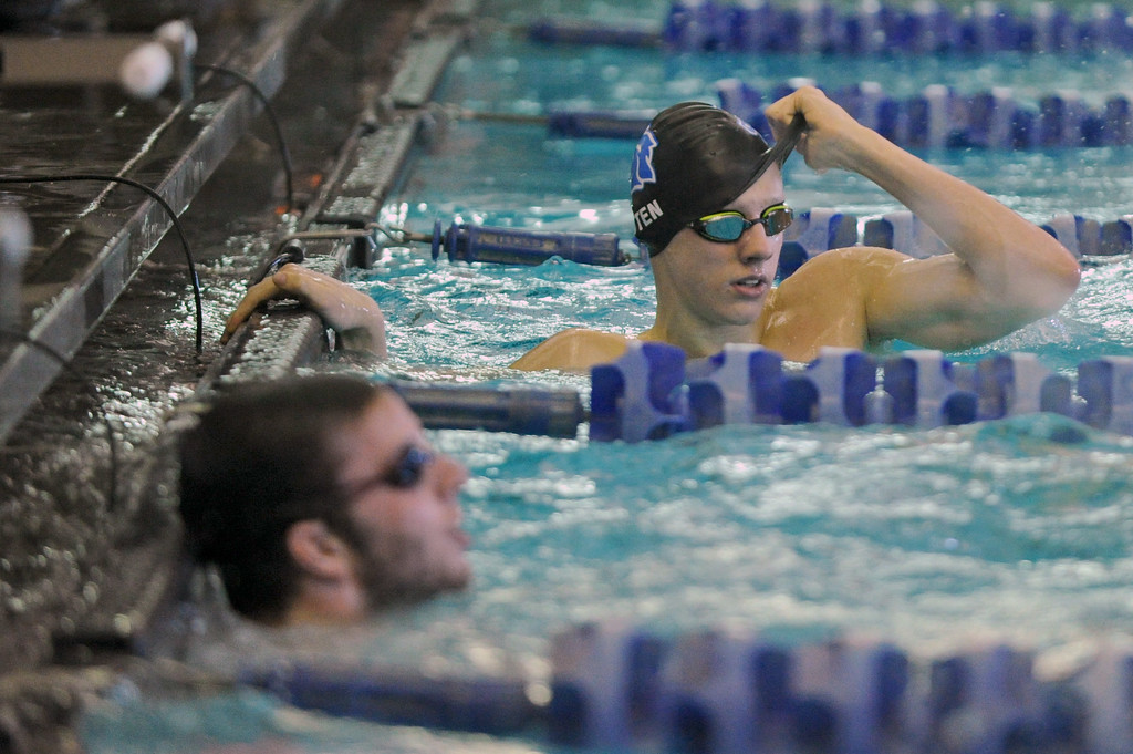 Oscar Patten peels off his cap after finishing the 100-meter freestyle at the Sheridan Invite on Saturday, Jan. 7 at Sheridan Junior High School. Mike Pruden   The Sheridan Press