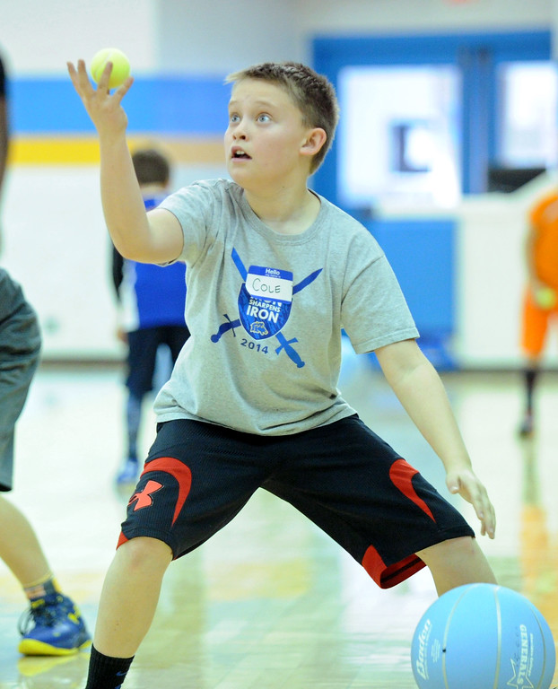 Cole Hansen utilizes a basketball and a tennis ball to work on his ball-handling skills at the Sheridan College men's basketball camp on Saturday, Jan. 7 at the Bruce Hoffman Golden Dome. Mike Pruden   The Sheridan Press