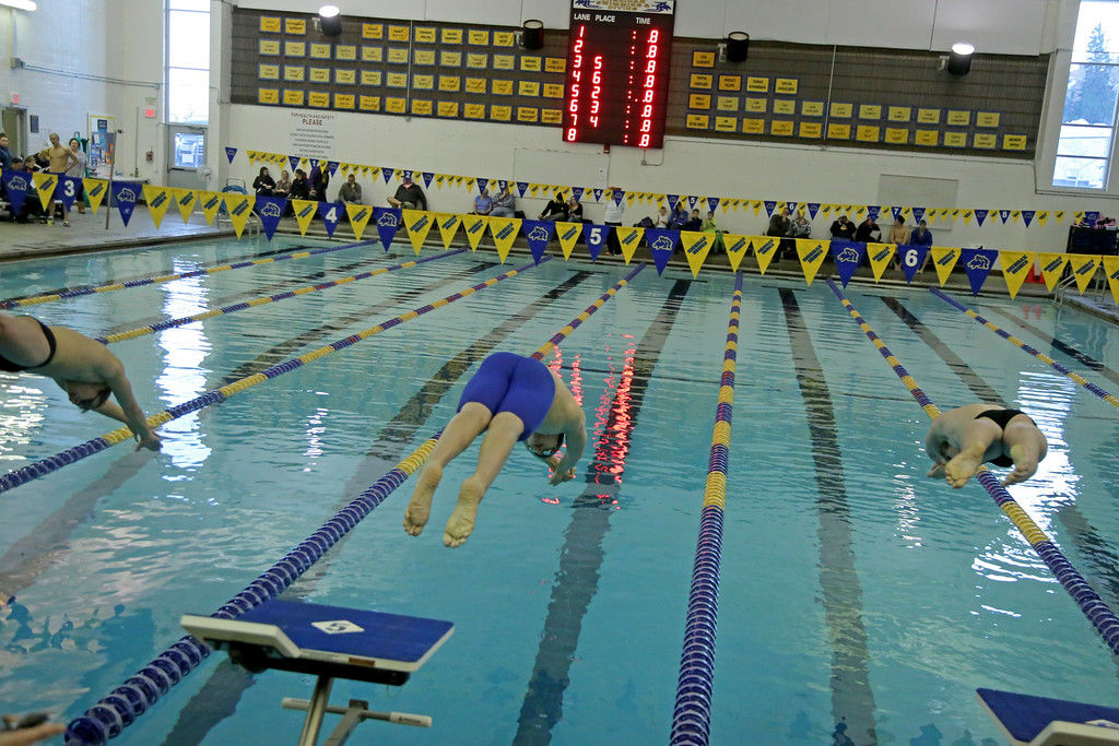 Caleb Johannesmeyer, center, dives off the block to start the 200-meter individual medley on Friday, Jan. 6 at Sheridan Junior High School. Mike Pruden   The Sheridan Press