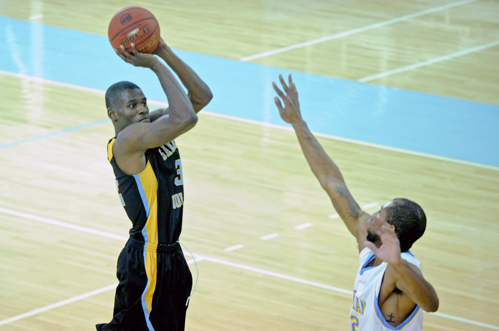 Dmonte Harris shoots a 3-pointer over a closing defender on Thursday, Jan. 5 at the Bruce Hoffman Golden Dome. Mike Pruden   The Sheridan Press
