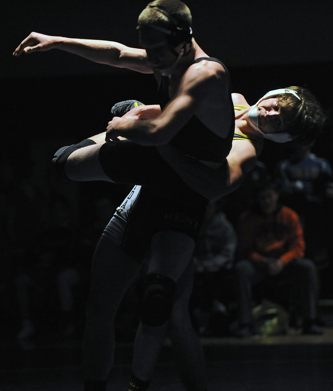 Mikel Dobson, right, throws his opponent to the mat during a match with Billings West on Tuesday, Jan. 3 at Sheridan High School. Mike Pruden   The Sheridan Press