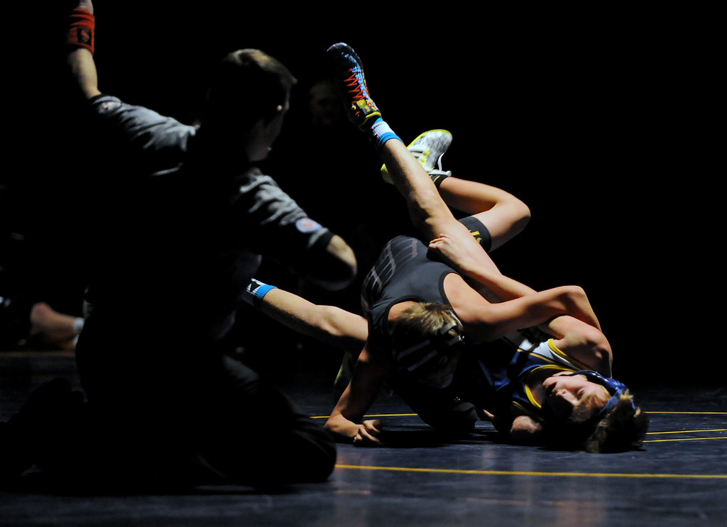 Conner Goss, right, rolls over Billings West's Wyatt Van Pelt during the 106-pound bout on Tuesday, Jan. 3 at Sheridan High School. Mike Pruden   The Sheridan Press
