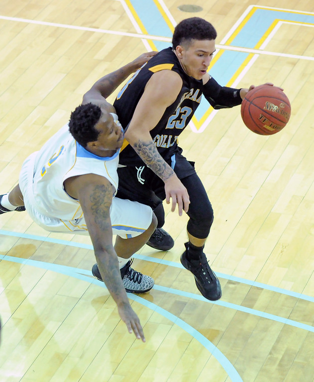 Antoine Proctor, left, grabs onto Sheridan College's Channel Banks as Banks drives to the basket on Thursday, Jan. 5 at the Bruce Hoffman Golden Dome. Mike Pruden   The Sheridan Press
