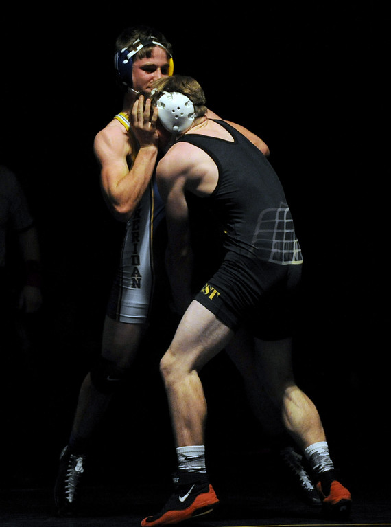 Quinn Heyneman pushes his opponent's face away from his chest during the 138-pound match on Tuesday, Jan. 3 at Sheridan High School. Mike Pruden   The Sheridan Press