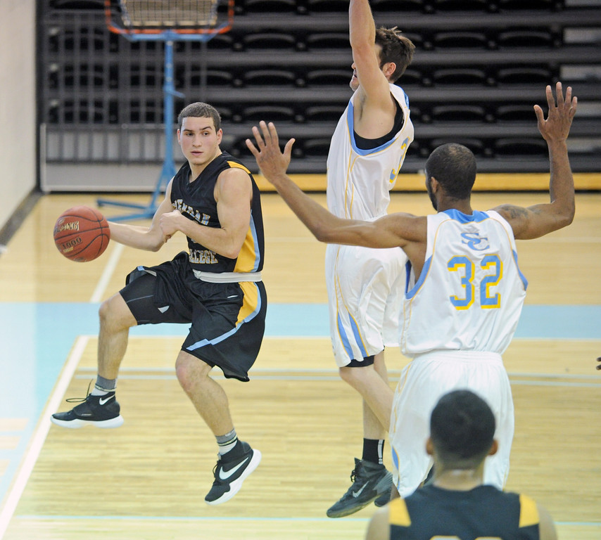 Sheridan College point guard Celio Araujo hangs in the air as he looks for an open pass against the Wyoming All-Stars on Thursday, Jan. 5 at the Bruce Hoffman Golden Dome. In its first game back after winter break, SC defeated the All-Stars 101-73. Mike Pruden   The Sheridan Press