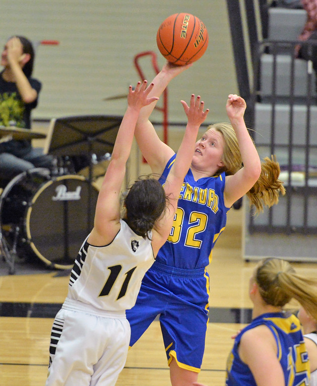 Katie Tomlinson takes the ball up for a layup against Cheyenne South's Karli Noble on Friday, Jan. 20 at Cheyenne South High School. Mike Pruden | The Sheridan Press
