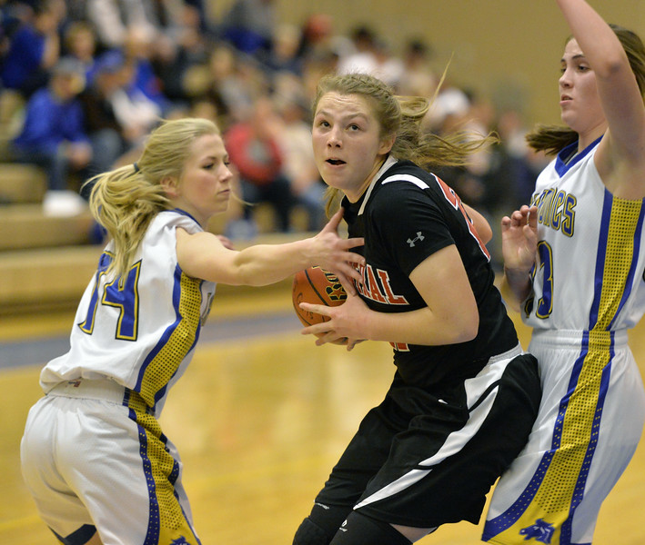 Abby Fearneyhough drives between two Sheridan defenders on Friday, Jan. 27 at Sheridan High School. Fearneyhough scored 14 points to lead Central over the Lady Broncs, 46-39. Mike Pruden | The Sheridan Press