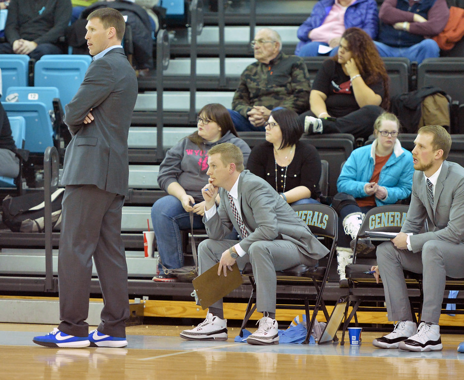 The Sheridan College men's basketball coaching staff, from left, Matt Hammer, Cody Ball and Tom parks, sport sneakers with their suits to show their support for cancer as part of the Coaches vs. Cancer game on Wednesday, Jan. 26 at the Bruce Hoffman Golden Dome. Mike Pruden | The Sheridan Press
