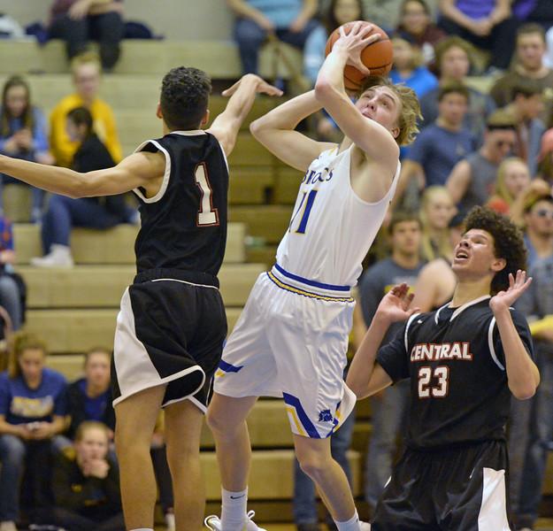 Drew Boedecker adjusts his shot against Cheyenne Central on Friday, Jan. 27 at Sheridan High School. Mike Pruden | The Sheridan Press
