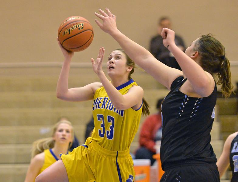 Bailey Coon avoids a shot blocker on Saturday, Jan. 28 at Sheridan High School. Mike Pruden | The Sheridan Press