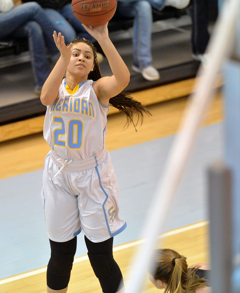 Rebekah Brewer fires a 3-pointer from the wing on Wednesday, Jan. 25 at the Bruce Hoffman Golden Dome. Mike Pruden | The Sheridan Press