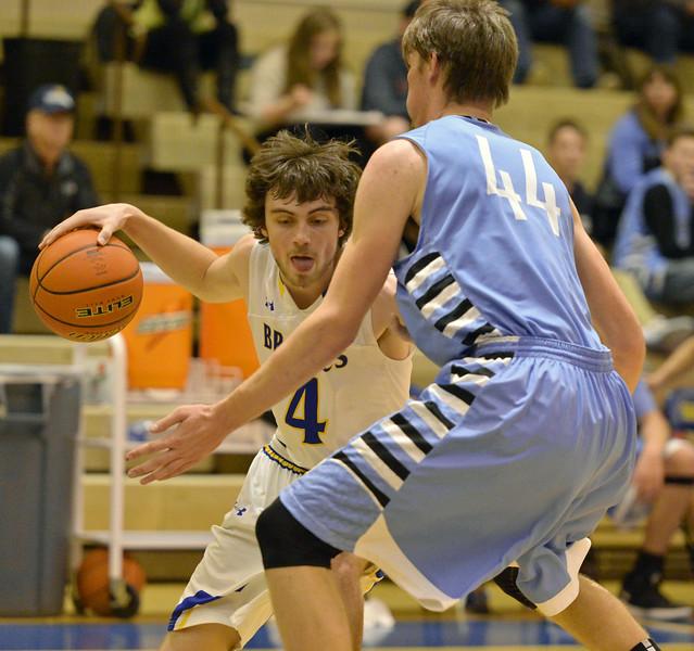 Aaron Woodward pulls back against a Cheyenne East defender on Saturday, Jan. 28 at Sheridan High School. Mike Pruden | The Sheridan Press