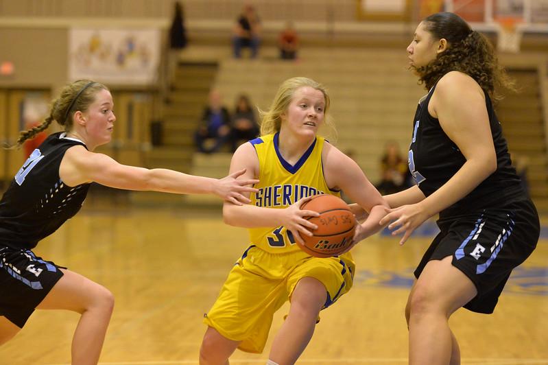 Katie Tomlinson, center, drives between two Cheyenne East defenders on Saturday, Jan. 28 at Sheridan High School. Mike Pruden | The Sheridan Press