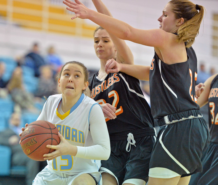 Sara Storeshaw, left, fights her way past two taller Central Wyoming defenders on Wednesday, Jan. 25 at the Bruce Hoffman Golden Dome. Mike Pruden | The Sheridan Press