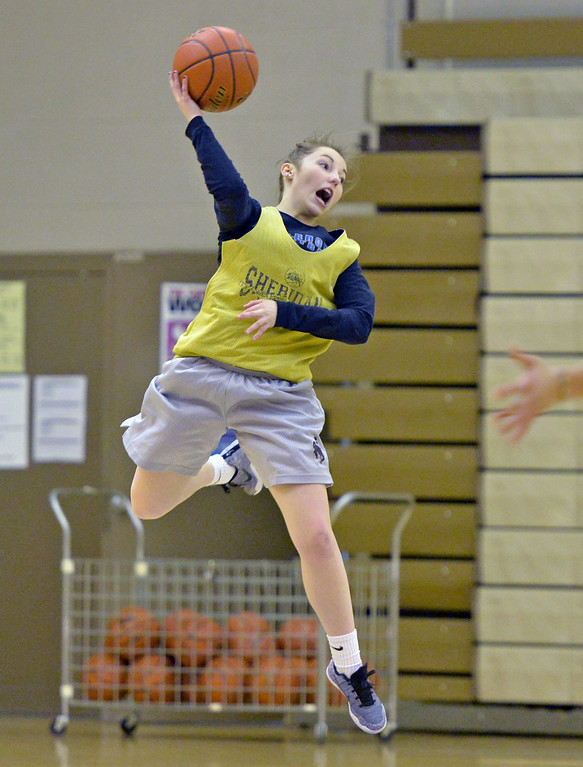 Alli Puuri stretches to save the ball along the baseline during a practice drill on Tuesday, Jan. 10 at Sheridan High School. Mike Pruden | The Sheridan Press