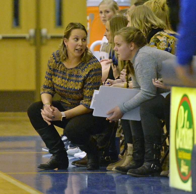 Head girls basketball coach Jessica Pickett converses with her assistants during the Lady Broncs' matchup with Billings Skyview on Friday, Jan. 13 at Sheridan High School. Mike Pruden | The Sheridan Press