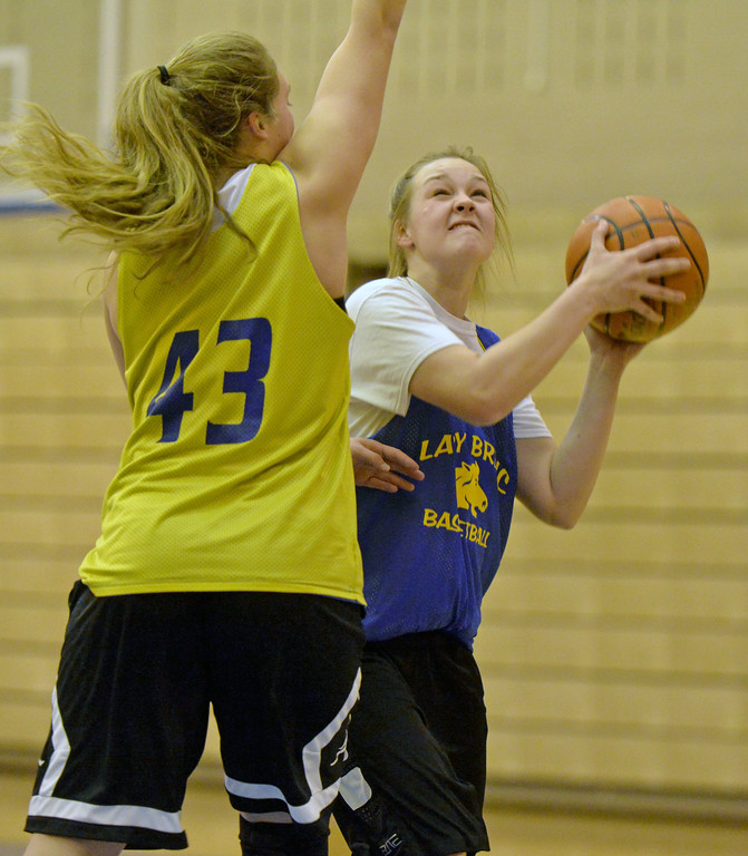 Kailee Ingalls makes a post move around teammate Jordan Christensen at practice on Tuesday, Jan. 10 at Sheridan High School. Mike Pruden | The Sheridan Press