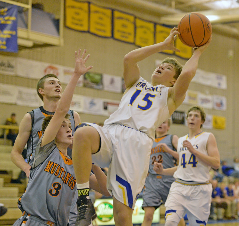 Tristan Bower falls away as he puts up a shot against Natrona County on Saturday, Jan. 14 at Sheridan High School. Mike Pruden | The Sheridan Press