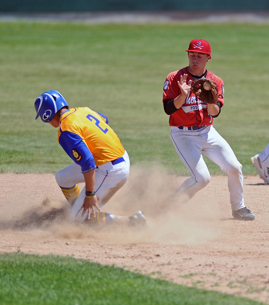 Second baseman Noah Gustafson, right, snags a throw as a Cody base runner slides safely into second base during Sheridan's doubleheader with Cody on Saturday, July 8 at Thorne-Rider Stadium. Mike Pruden | The Sheridan Press