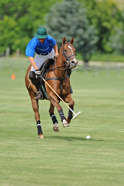 Charlie Caldwell reaches for the ball during a Big Horn Polo Club match on Sunday, July 2 at the Big Horn Equestrian Center. Mike Pruden | The Sheridan Press