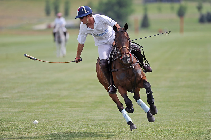 Liam Lott hits the ball backward during a Big Horn Polo Club match on Sunday, July 2 at the Big Horn Equestrian Center. Mike Pruden | The Sheridan Press