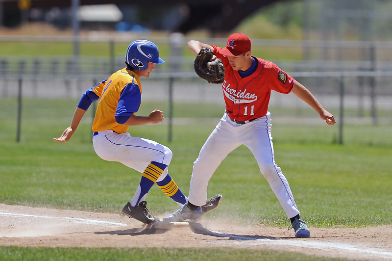 Quinton Brooks stretches to attempt an out at first base during Sheridan's doubleheader with Cody on Saturday, July 8 at Thorne-Rider Stadium. Mike Pruden | The Sheridan Press