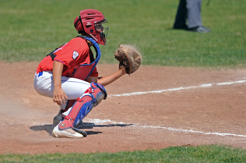 Kade Eisele makes a catch at home plate to hold a runner at third during Sheridan's doubleheader with Cody on Saturday, July 8 at Thorne-Rider Stadium. Mike Pruden | The Sheridan Press