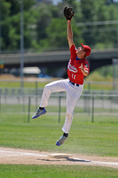 First baseman Quinton Brooks leaps to snatch a throw from the outfield during Sheridan's doubleheader with Cody on Saturday, July 8 at Thorne-Rider Stadium. Mike Pruden | The Sheridan Press