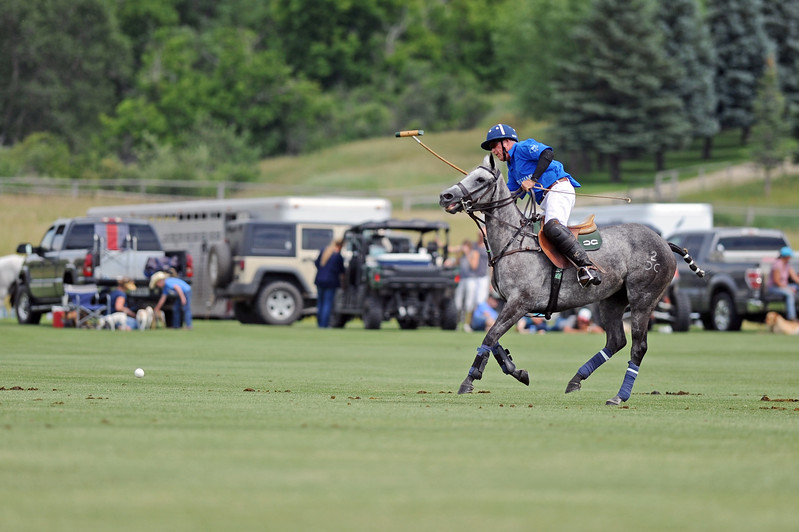 Joe Fitzsimmons moves the ball downfield during a Big Horn Polo Club match on Sunday, July 2 at the Big Horn Equestrian Center. Mike Pruden | The Sheridan Press