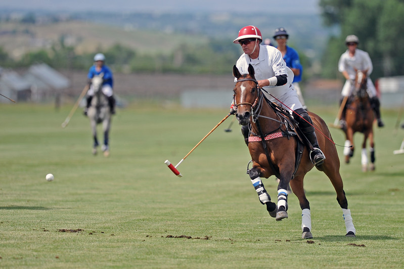 Steve Dalton punches the ball through the goal during a Big Horn Polo Club match on Sunday, July 2 at the Big Horn Equestrian Center. Mike Pruden | The Sheridan Press