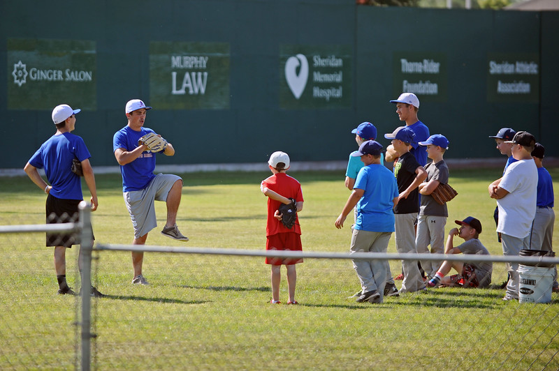 Troopers assistant coach Blake Godwin instructs a group at baseball camp on Friday, July 7 at Thorne-Rider Stadium. Mike Pruden | The Sheridan Press
