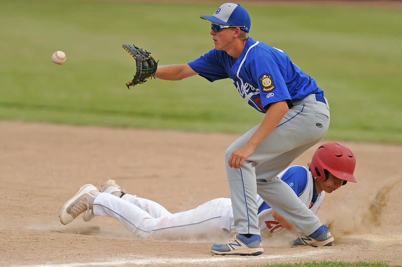 Sheridan's Kade Eisele dives safely back to first base on a pick-off attempt during the Troopers' 8-7 win over Laurel on Wednesday, July 5 at Thorne-Rider Stadium. Mike Pruden | The Sheridan Press