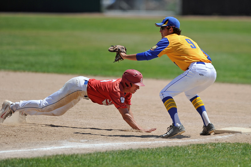Jeff Shanor dives back to first base on a pick-off attempt during Sheridan's doubleheader with Cody on Saturday, July 8 at Thorne-Rider Stadium. Mike Pruden | The Sheridan Press