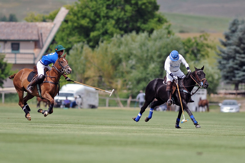 Charlie Caldwell, left, tries to slow down Wayne Garrison during a Big Horn Polo Club match on Sunday, July 2 at the Big Horn Equestrian Center. Mike Pruden | The Sheridan Press