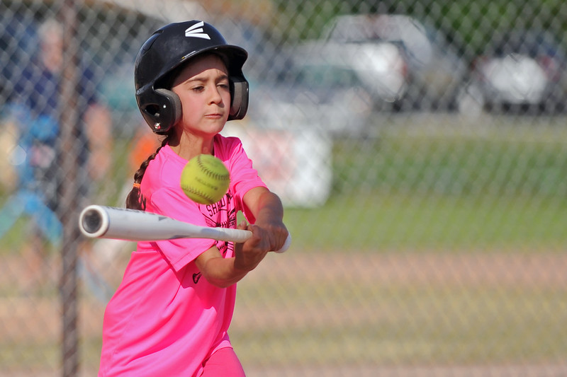 Lilli Sutphin knocks the ball to the infield during Sheridan Recreation District softball on Monday, July 10 at Sixth Street Fields. Mike Pruden | The Sheridan Press