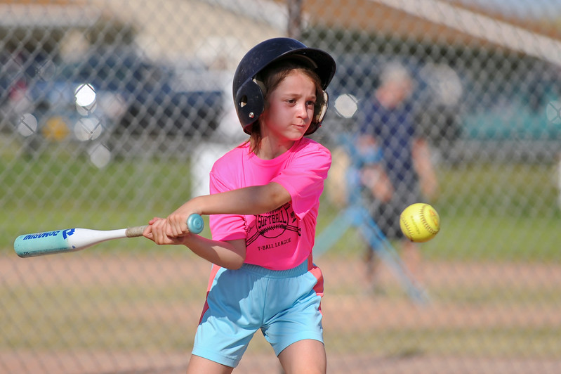 Addison Hale keeps her eye on the ball as she readies a swing during Sheridan Recreation District softball on Monday, July 10 at Sixth Street Fields. Mike Pruden | The Sheridan Press