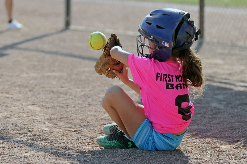 Catcher Izzy Dennee sits to block a throw behind the plate during Sheridan Recreation District softball on Monday, July 10 at Sixth Street Fields. Mike Pruden | The Sheridan Press