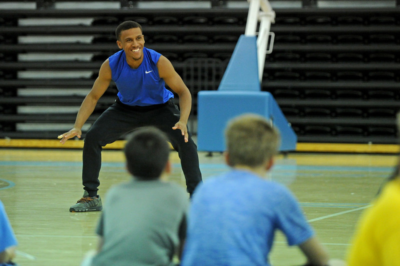 Sheridan College incoming freshman Josh Bagley demonstrates a defensive drill during basketball camp on Wednesday, June 14 at the Bruce Hoffman Golden Dome. Mike Pruden | The Sheridan Press