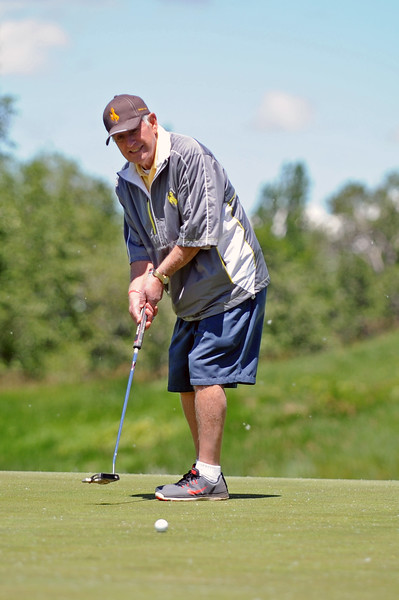 Sandy Michelena watches a putt on the Stag eighth green during the Give Kids the World golf tournament on Saturday, June 17 at the Powder Horn. Mike Pruden | The Sheridan Press