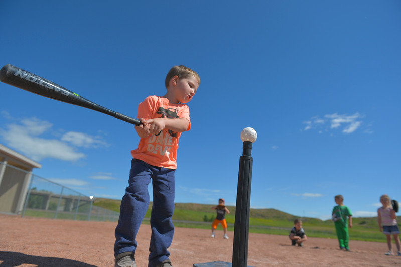 Justin Sheely | The Sheridan Press<br /> Four-year-old Tanner Barton aims at the ball during Itty Bitty T-Ball basics Wednesday at the Ranchester Ball Field. Tongue River Valley Community Center offered a four day introduction aimed at youngsters, between ages four and five, to learn the basics of t-ball.