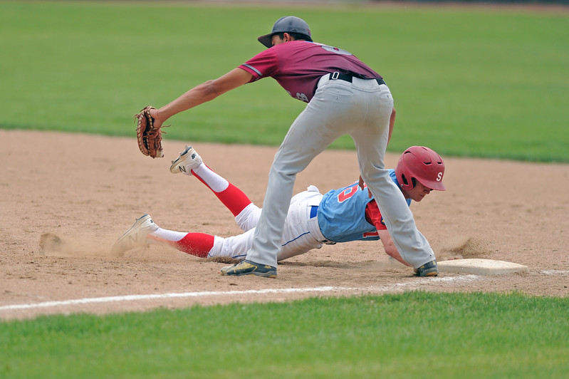 Andrew Ratty dives safely back to first base on a pickoff attempt on Tuesday, June 20 at Thorne-Rider Stadium. Mike Pruden | The Sheridan Press