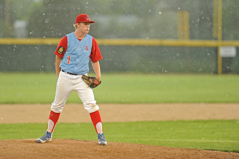 Sheridan's Jacob Boint readies a pitch as high winds blow cotton from cottonwood trees on Tuesday, June 20 at Thorne-Rider Stadium. Strong wind and heavy rain delayed the Troopers' doubleheader with Riverton, but the teams were able to resume play in Sheridan's two-game sweep. Mike Pruden | The Sheridan Press