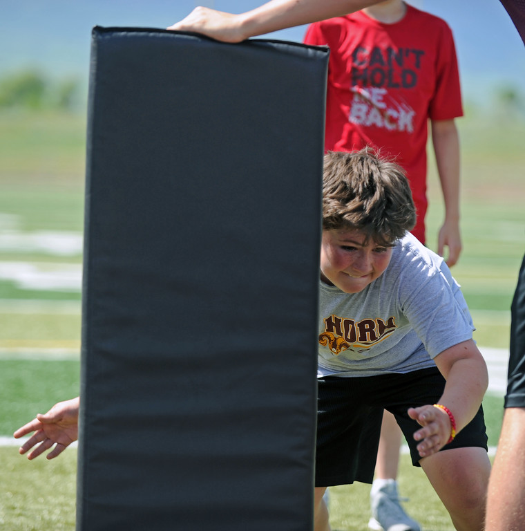 Gage Neeson tackles a pad during the Justin O'Dell Memorial Football Camp on Thursday, June 8 at Big Horn High School. Mike Pruden | The Sheridan Press