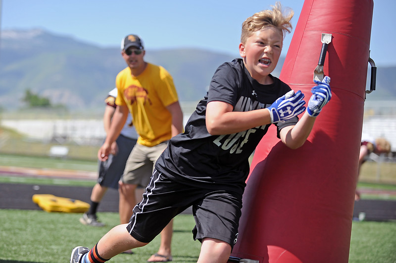 Josh Thompson pushes through a linemen drill during the Justin O'Dell Memorial Football Camp on Thursday, June 8 at Big Horn High School. Mike Pruden | The Sheridan Press