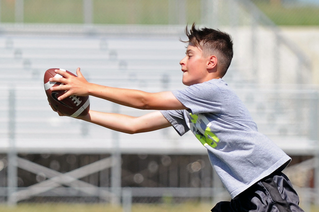 Chase Bales reaches out to make a catch during the Justin O'Dell Memorial Football Camp on Thursday, June 8 at Big Horn High School. Mike Pruden | The Sheridan Press