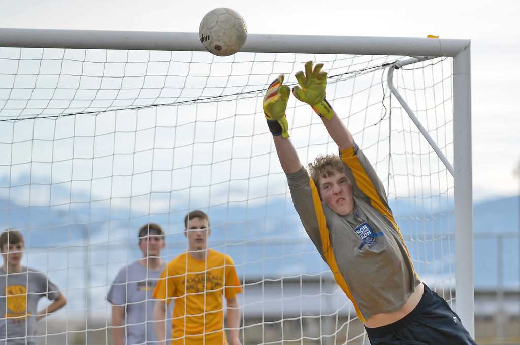 Ben Lecholat reaches for a save during soccer practice on Wednesday, March 15 at Homer Scott Field. Mike Pruden | The Sheridan Press