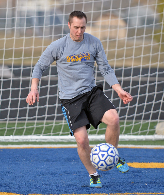 Sheridan High School head boys soccer coach Matt Johnson steps into the box to play goalkeeper during practice on Wednesday, March 15 at Homer Scott Field. Mike Pruden | The Sheridan Press